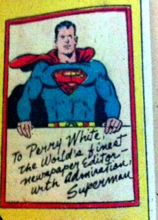 I like to believe that Superman got a glossy photo taken while holding a giant white board. It solves layout problems for where to put his autograph.