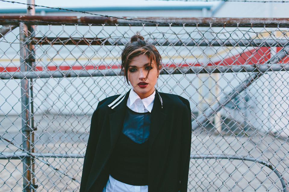 Street Style Fashion Portrait with City Fence