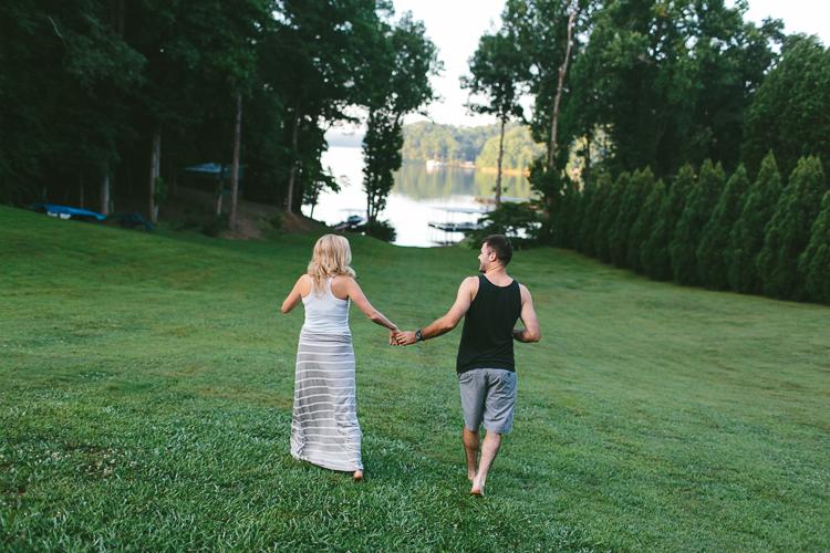 Engaged Couple Walking Holding Hands