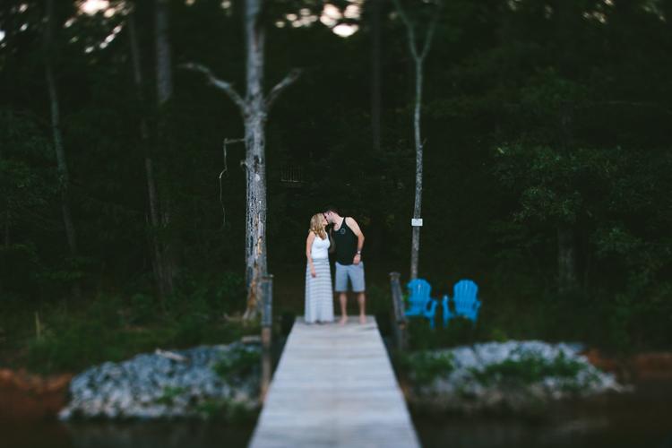 Engaged Couple Kissing on Boat Dock