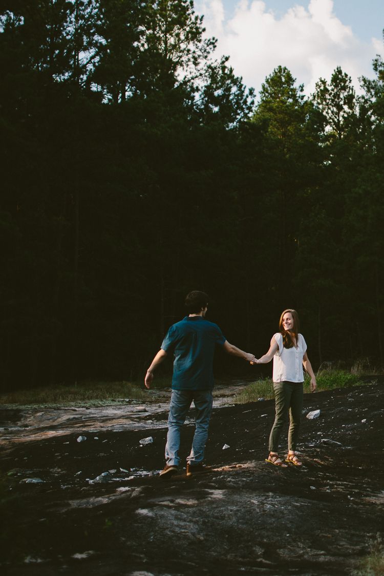 Engaged Couple Holding Hands on Arabia Mountain