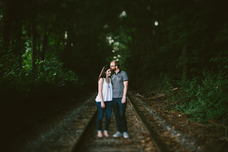 Sweet Forehead Kiss on the Train Tracks