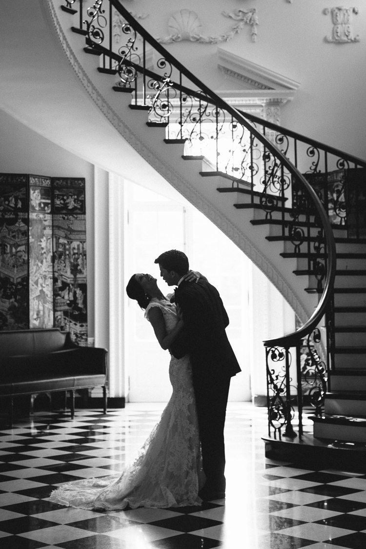 Black and White Bride and Groom Portrait Under Spiral Staircase