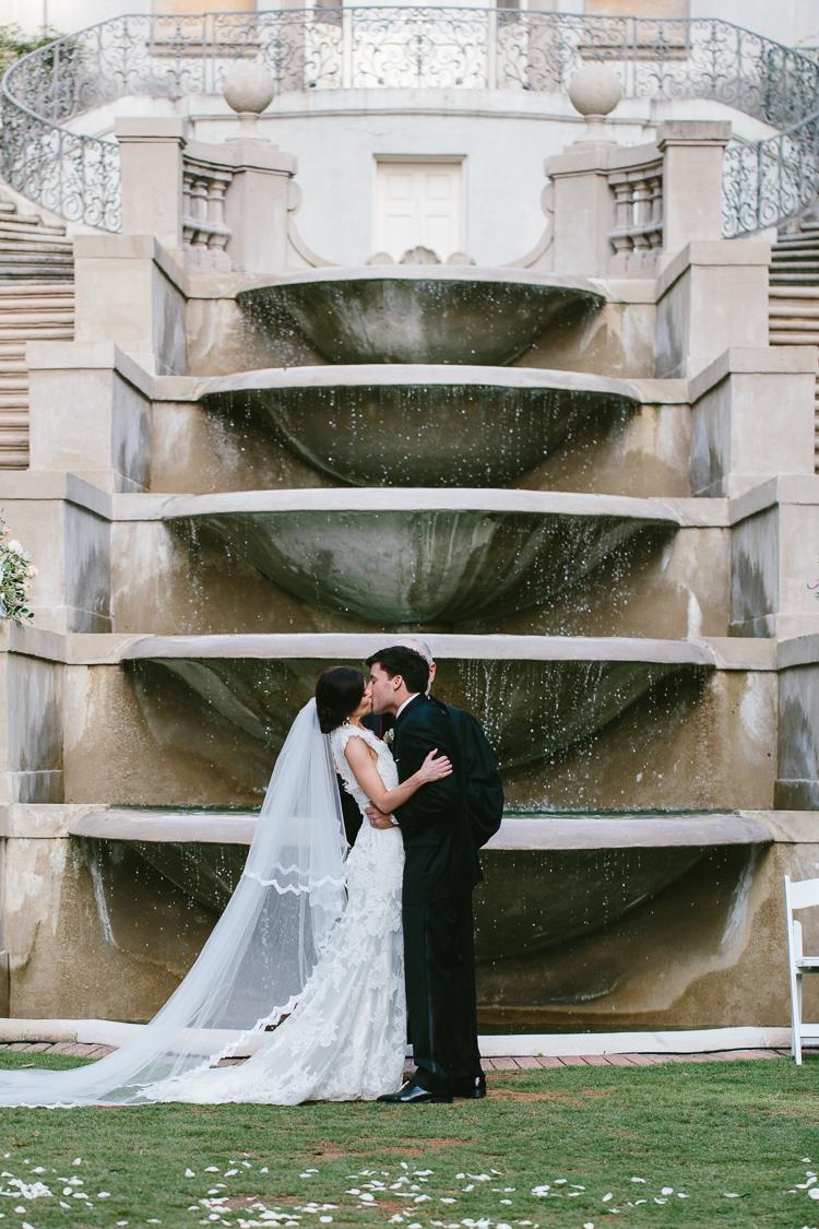 Bride and Groom Kiss at Fairytale Swan House Wedding