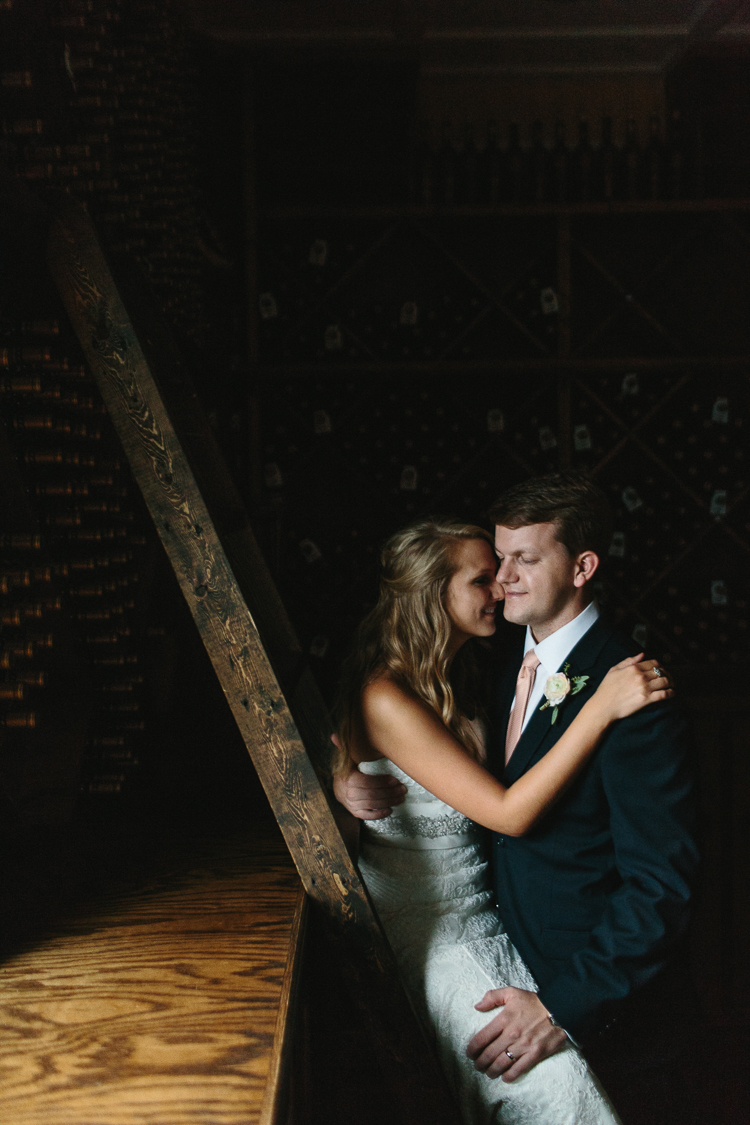 A Special Moment Between the Bride and Groom in the Wine Cellars