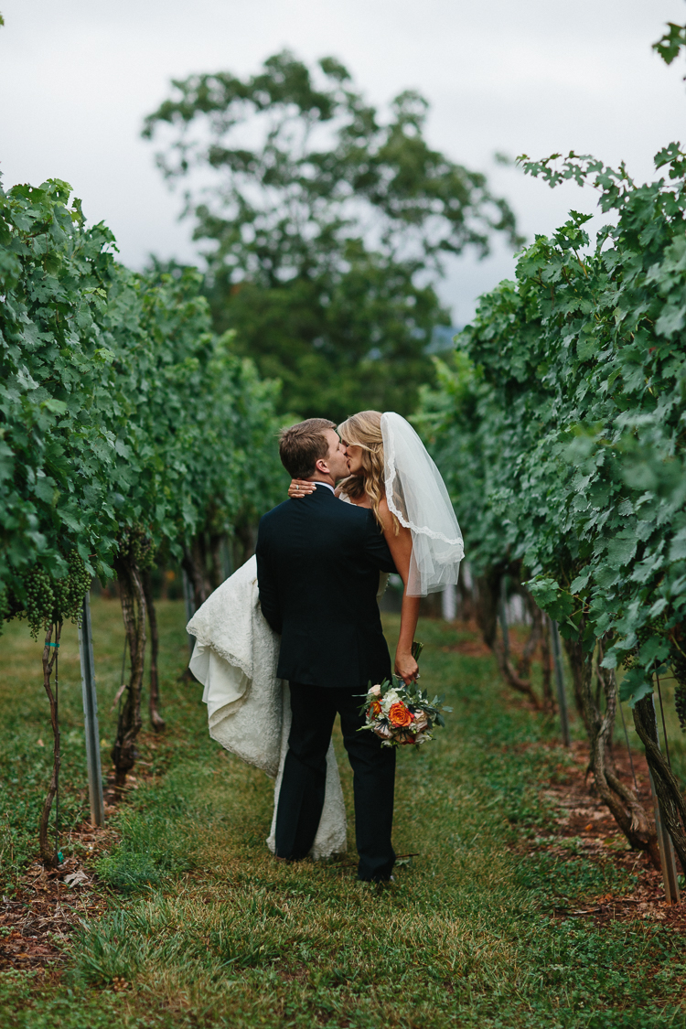 An Intimate Kiss Shared by the Bride and Groom in the Wolf Mountain Vinyard