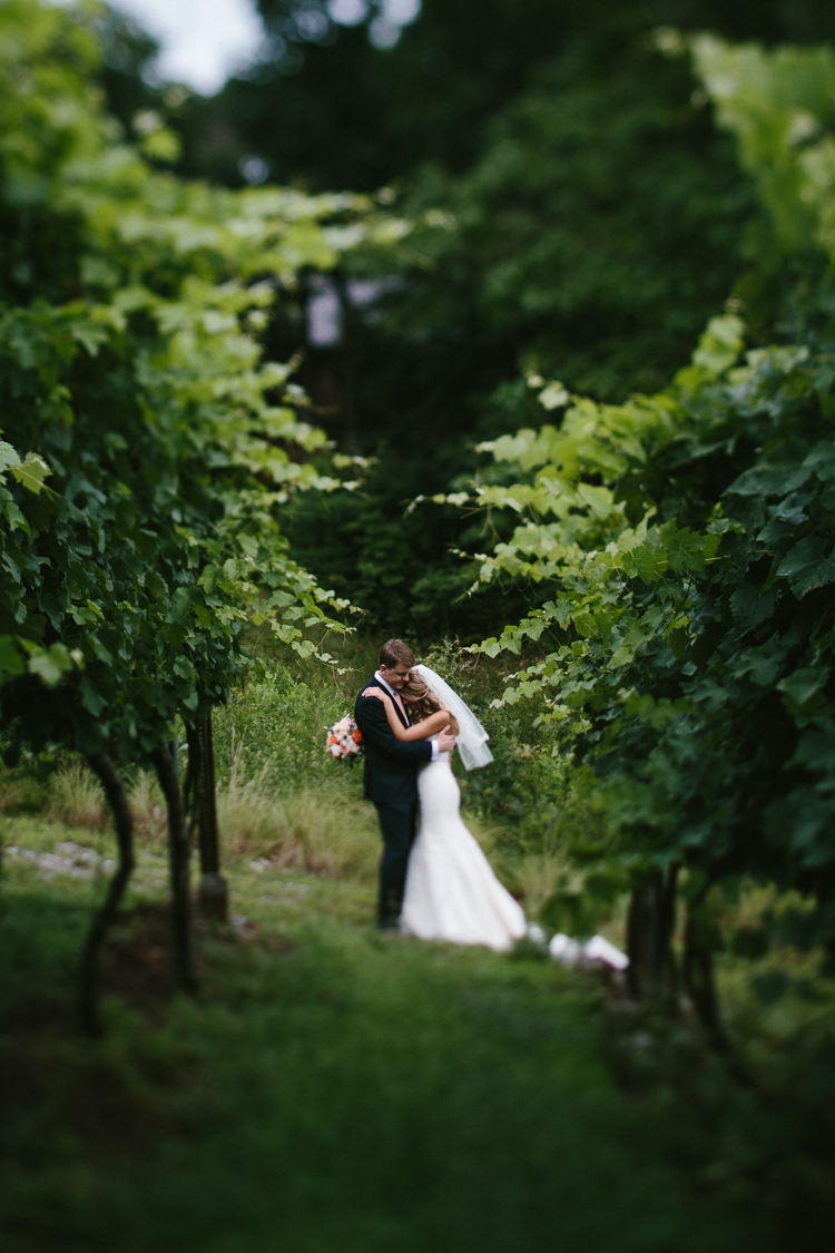 Sweet Moment Shared by the Bride and Groom in the Vinyard