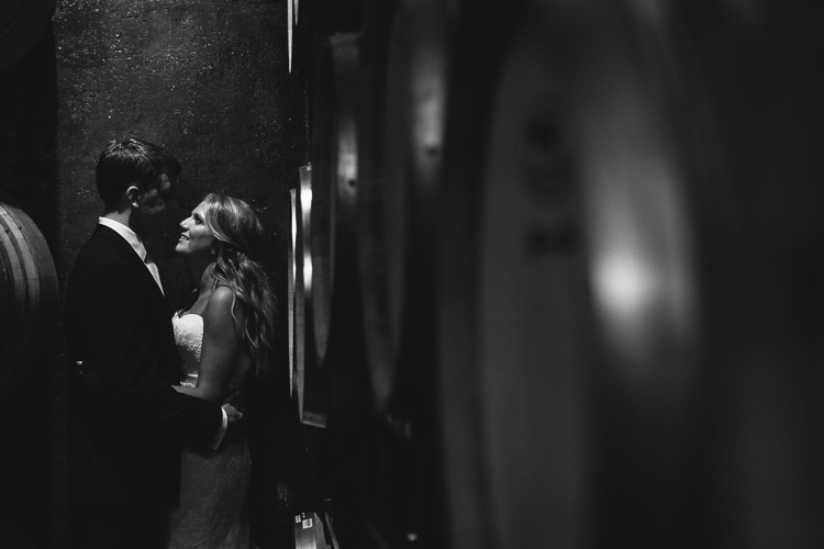 Black and White Portrait of the Bride and Groom in the Wine Cellars