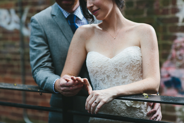 Bride and groom admiring ring