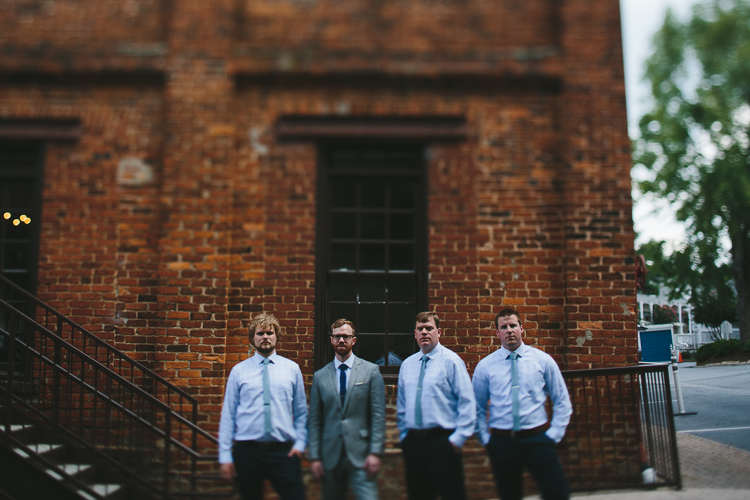 Urban groomsmen portrait