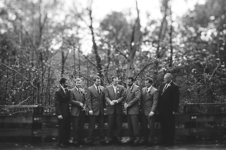 Black and white shot of groom and his groomsmen