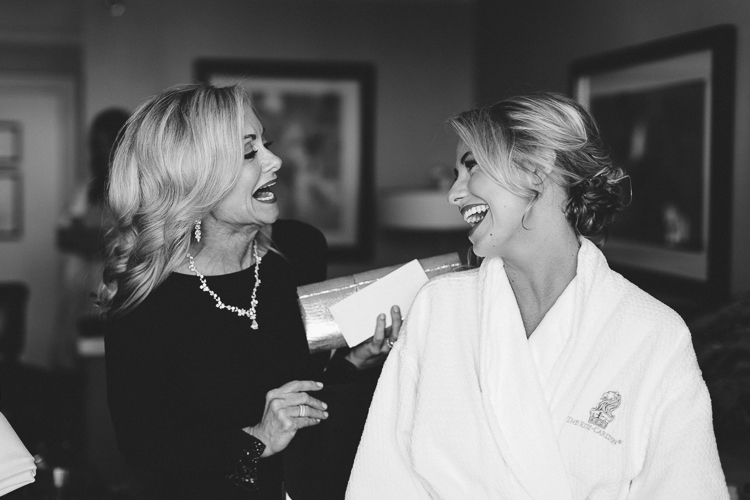 mother and daughter getting ready before wedding