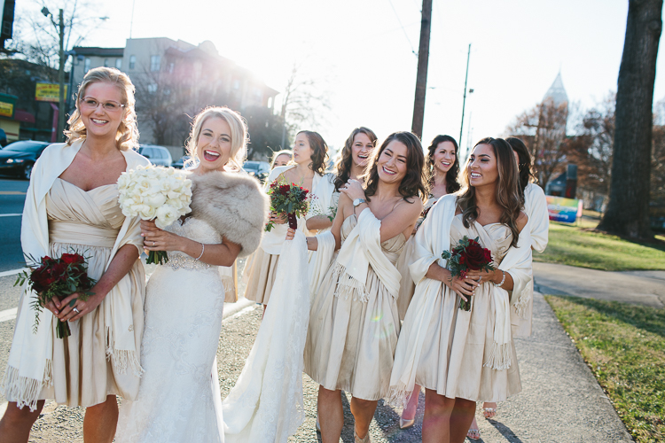 bride and her bridesmaids walking down the street together