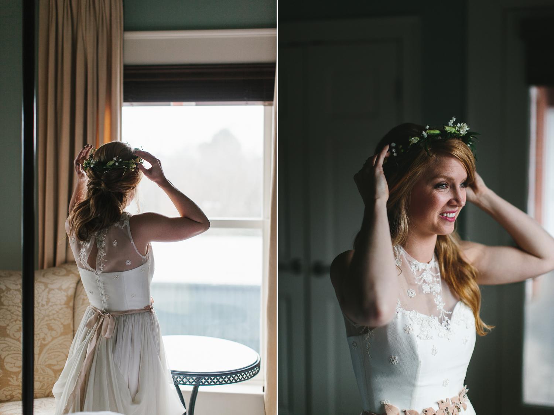 bohemian bride putting on her flower crown