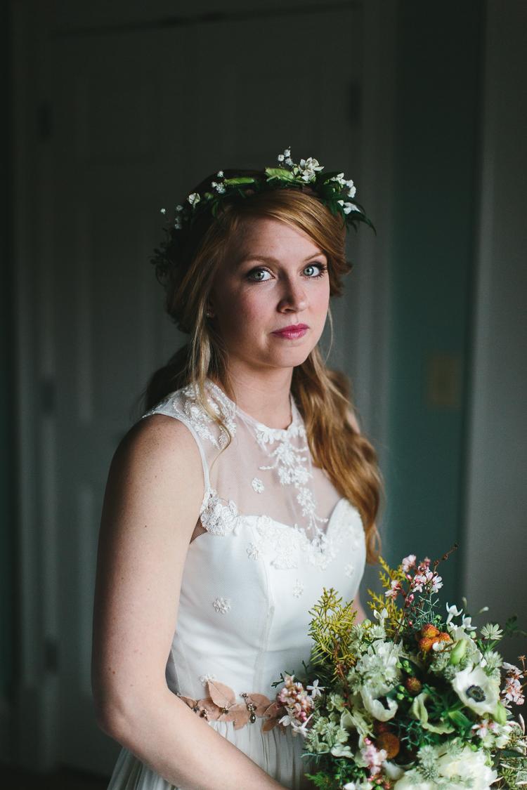 beautiful bohemian bride portrait with flower crown