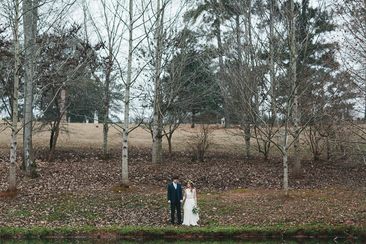 bride and groom portraits by pond