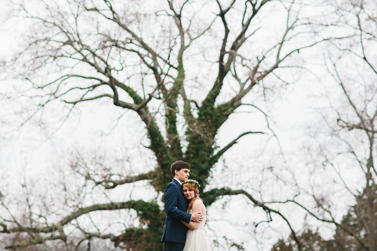 bride and groom in front of huge tree