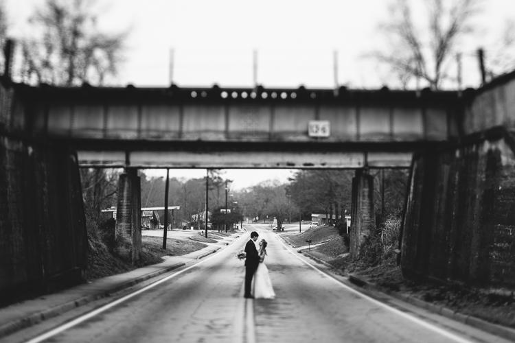 bride and groom under bridge