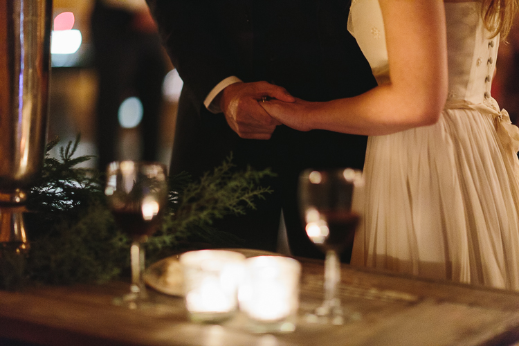 bride and groom holding hands after taking communion