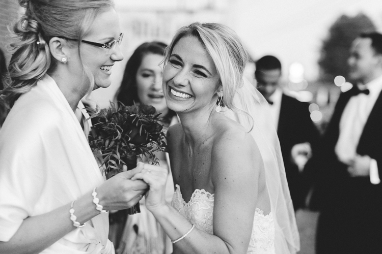 bride and sister after ceremony