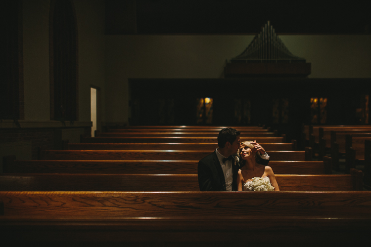 sweet moment between bride and groom in the church after the wedding