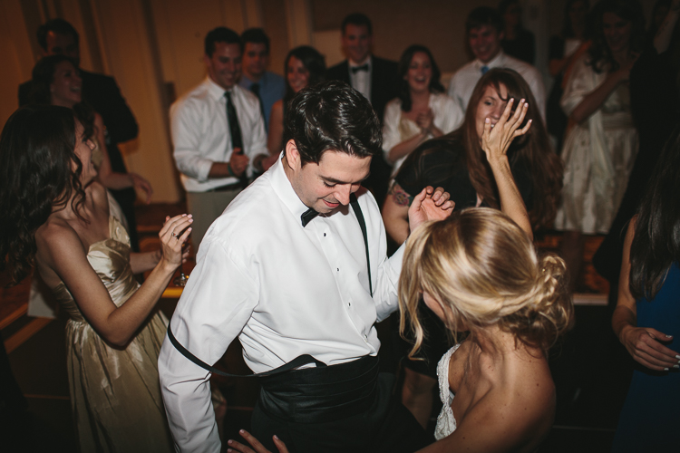 bride and groom getting down on the dance floor