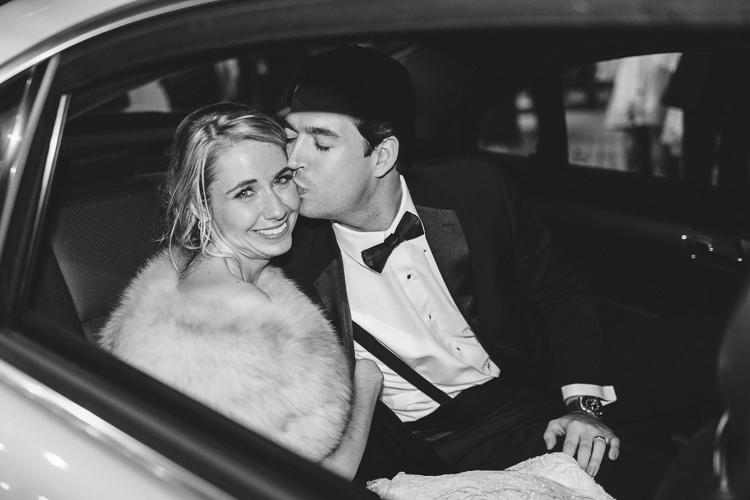 bride and groom leaving in car