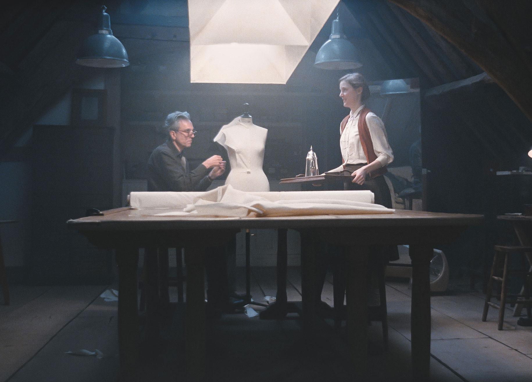Alma (Vicky Krieps) visits Reynolds (Daniel Day-Lewis) in his workshop