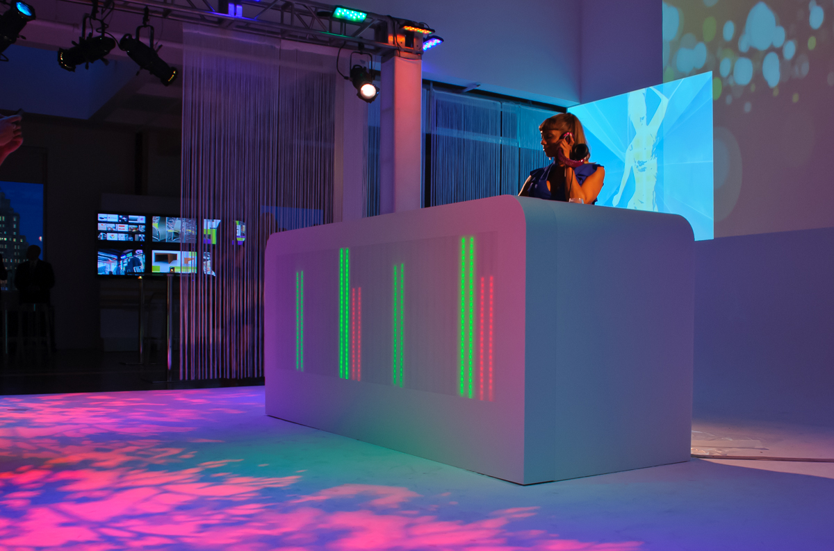 Backlit LED display moves up and down to the music in this DJ booth. Design by Russ Perry - Keane Creative. Fabrication by Sterling Surfaces. Photo by Jeff Baumgart.