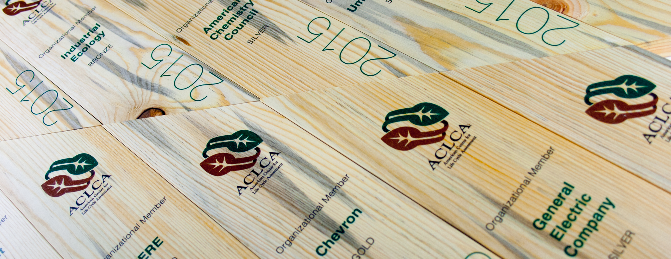 aclca - custom award using recovered pine beetle wood, eco-friendly & sustainable.