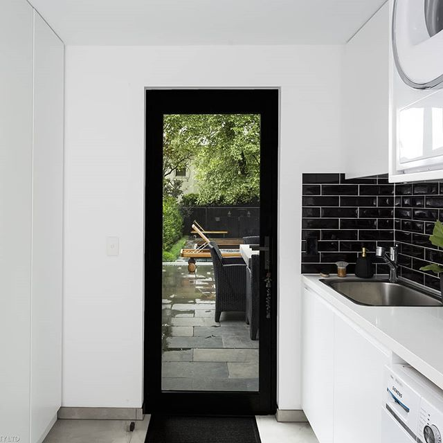 Striking black and white laundry fitout with a fantastic view at our recent Victoria st project  #archdaily #architecture #melbourne #melbourneinteriors #melbournearchitecture #interiordesign #interiors #laundry