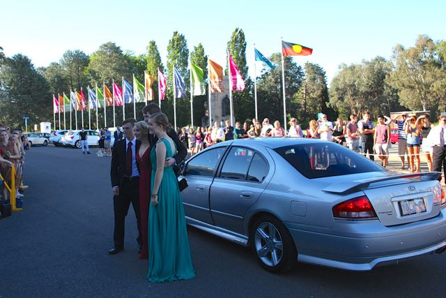 It was fun to see the arrivals at Old Parliament House. You can't see in this shot thatthere are a couplehundred people there to watch, paparazzi style. Couples come in bothfancy and funny ways from Ferraris to fire trucks. There waseven a couple who arrived inkayaks ona trailer.