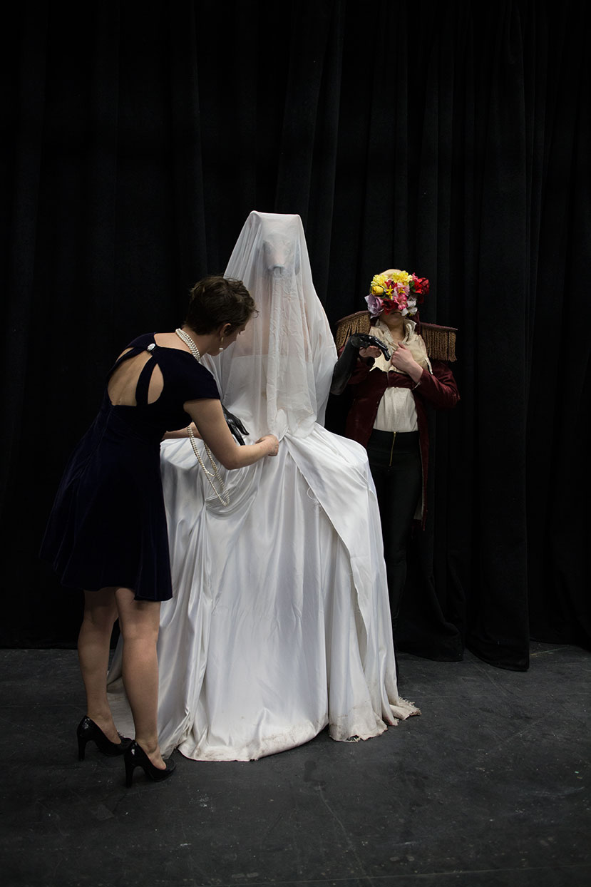 Tweaking before the final presentation, the Wolf as the Bride, Red as the Groom.  Q. Cassetti, 2014, Canon EOS-M.