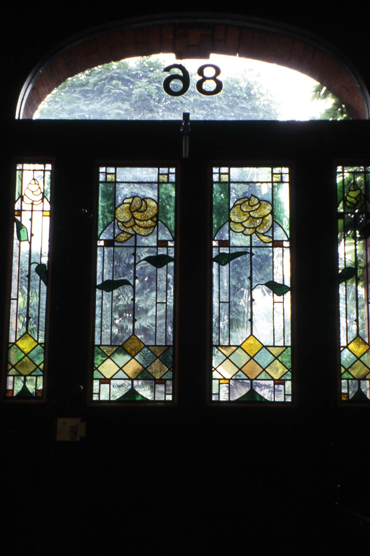 Roses front door and panels. Highbury, London.