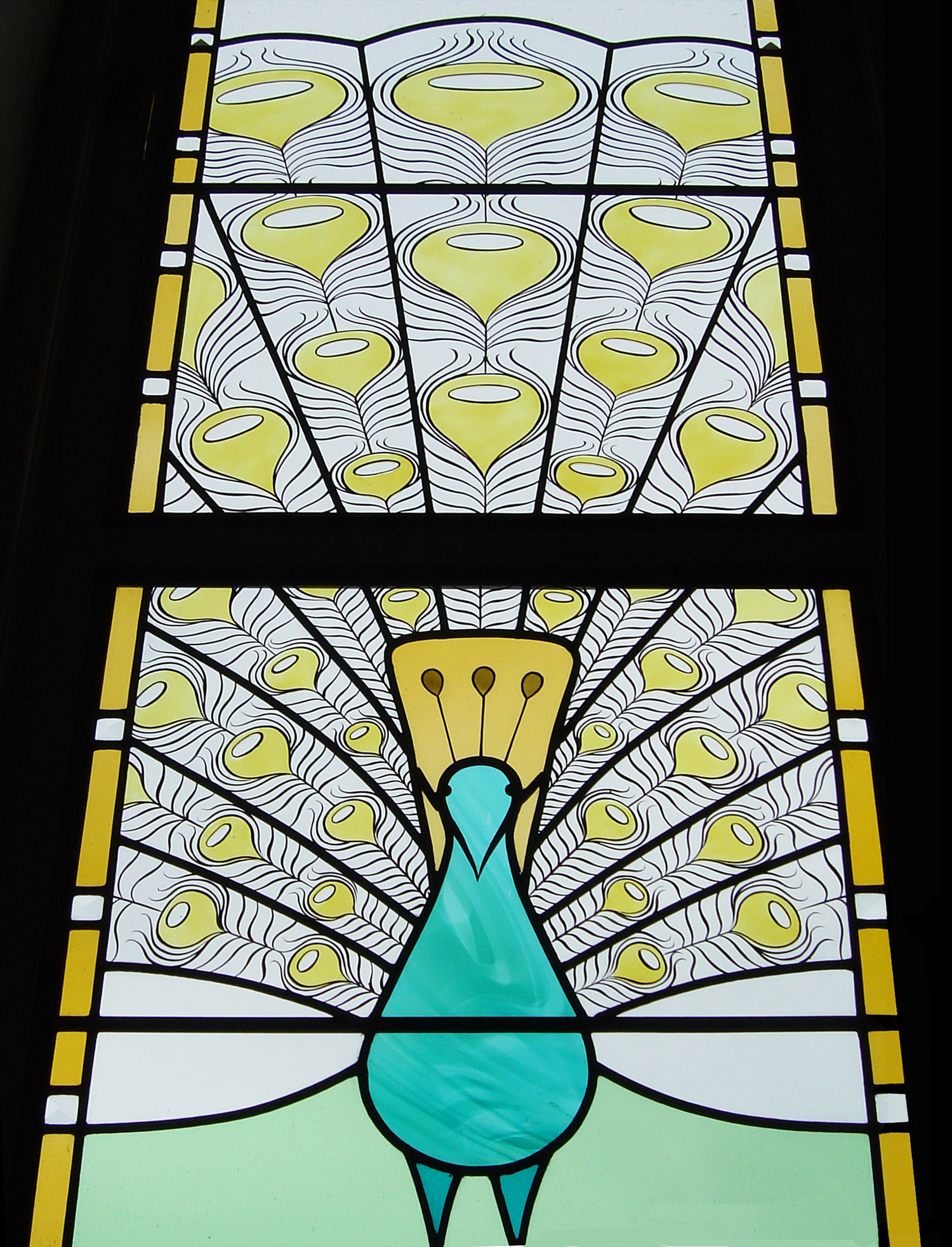 Detail of Peacock windows, Caterham.