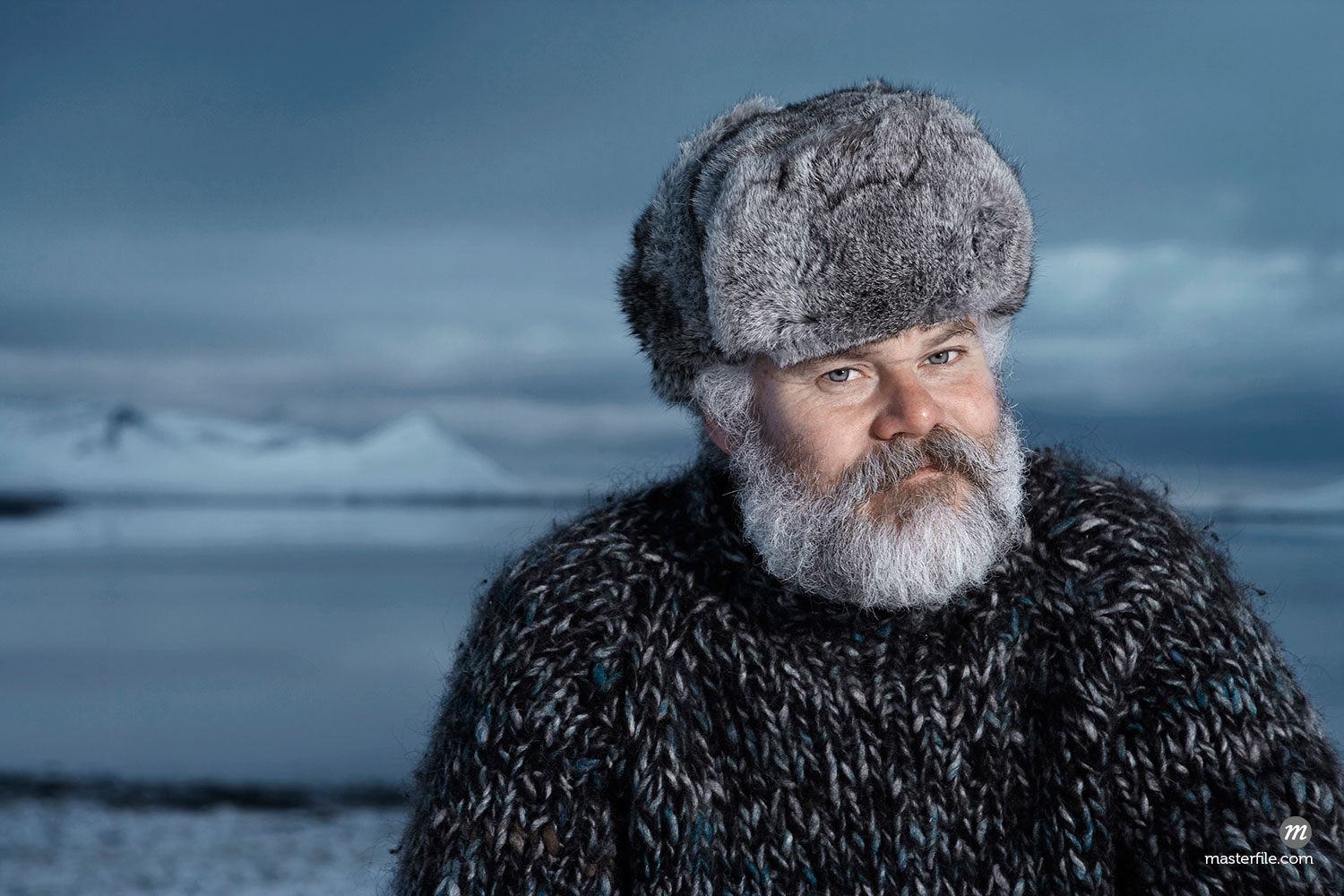 Man with gray beard wearing gray fur hat outdoors at winter in Iceland  ©  Atli Mar Hafsteinsson / Masterfile