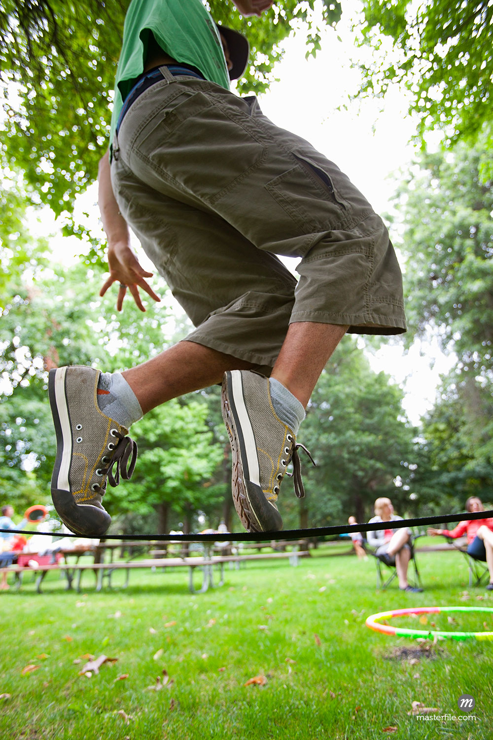 Close-Up of Man on Slackline  ©  Ty Milford / Masterfile