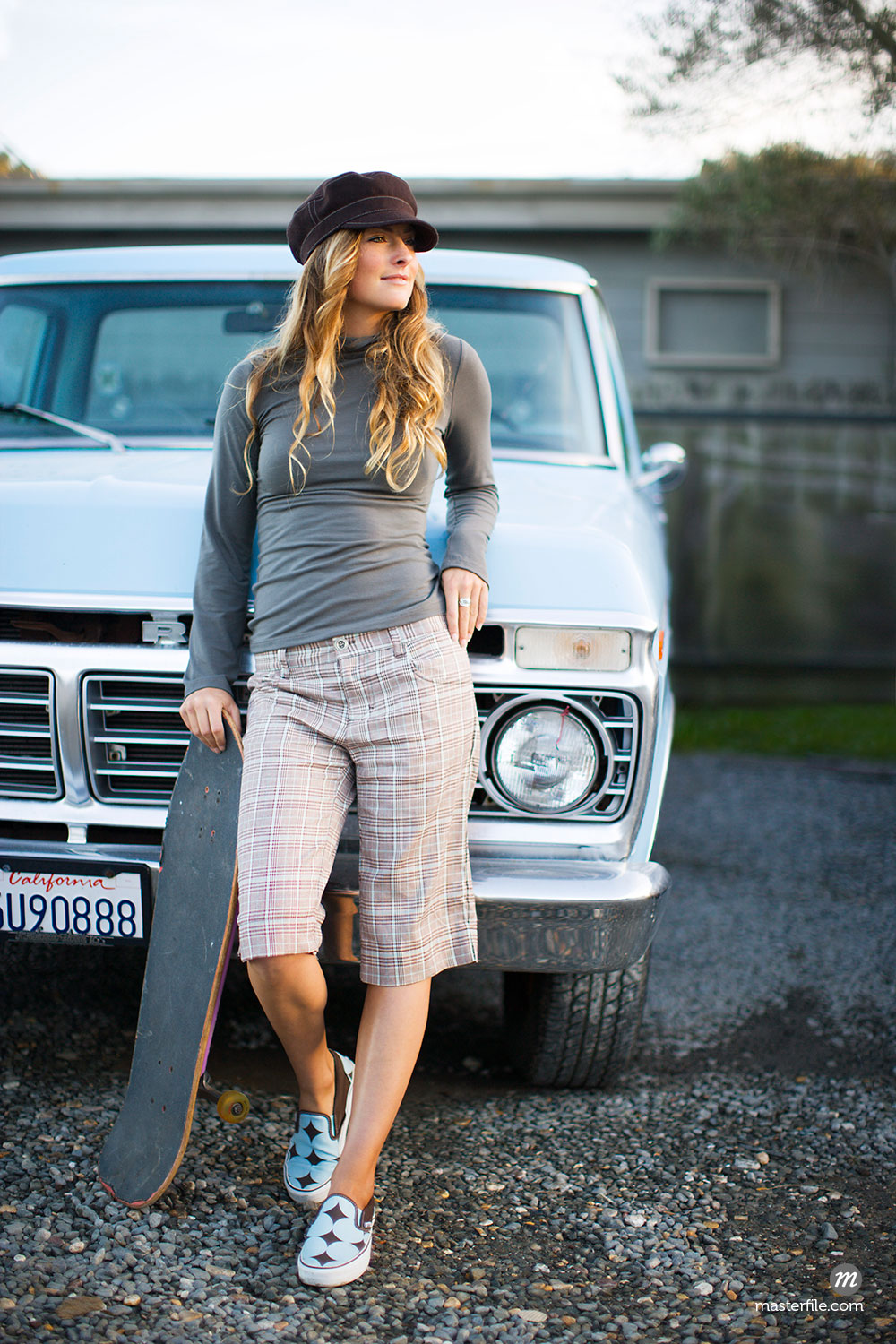 Portrait of Skateboarder Leaning Against Truck, Mill Valley, California  ©  Ty Milford / Masterfile