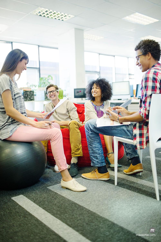 Business people talking in meeting  © Masterfile Royalty-Free (in  Team Meeting )