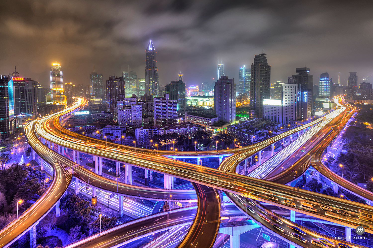 Yan'an Road with People's Square in the background at Night, Shanghai, China  © Siephoto / Masterfile