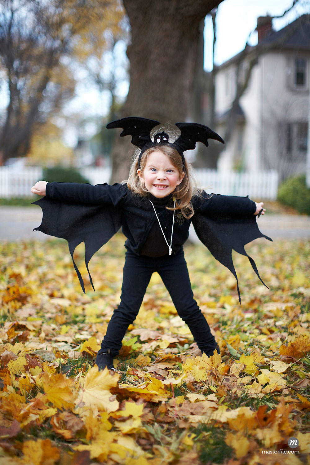 Girl in Bat Costume at Halloween in Toronto, Canada  ©  Michael Alberstat / Masterfile