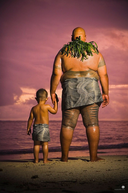 Father and son on beach in Samoa  ©  R. Ian Lloyd / Masterfile
