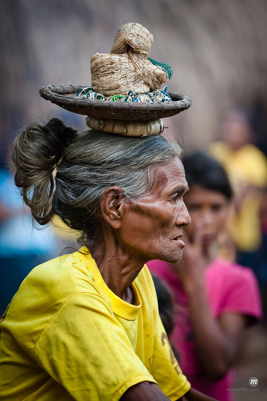 Woman with Basket on Head, Waihola Village, Sumba, Indonesia  ©  R. Ian Lloyd / Masterfile