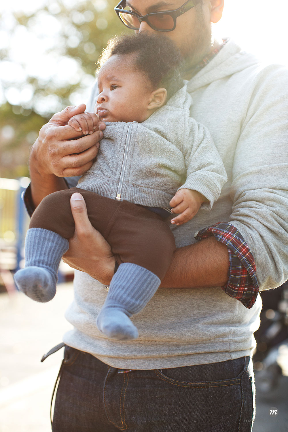 Father holding African American baby boy  © Masterfile