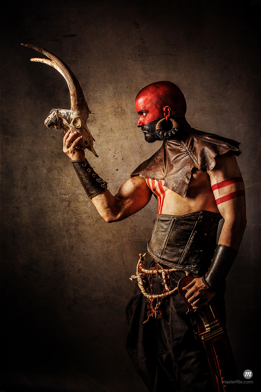Fantastical male tribal warrior  © Photononstop / Masterfile