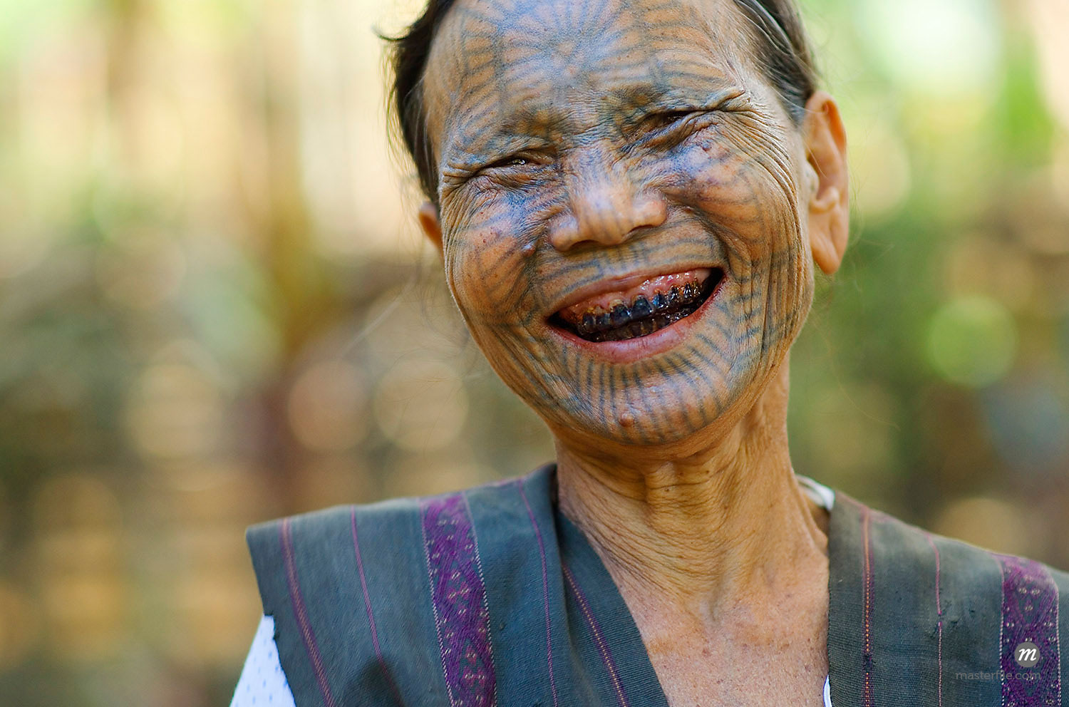 Tattoed Shan Tribal Woman, Mrauk-Oo, Myanmar  © Albert Normandin / Masterfile