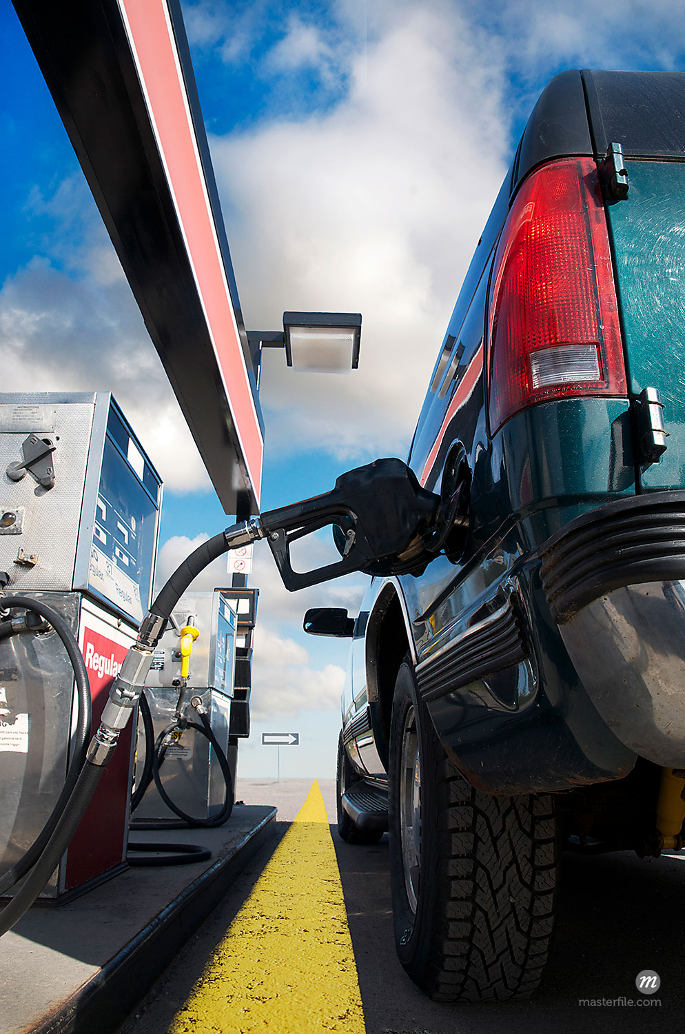 Truck being filled up at gas station  © Andrew Kolb