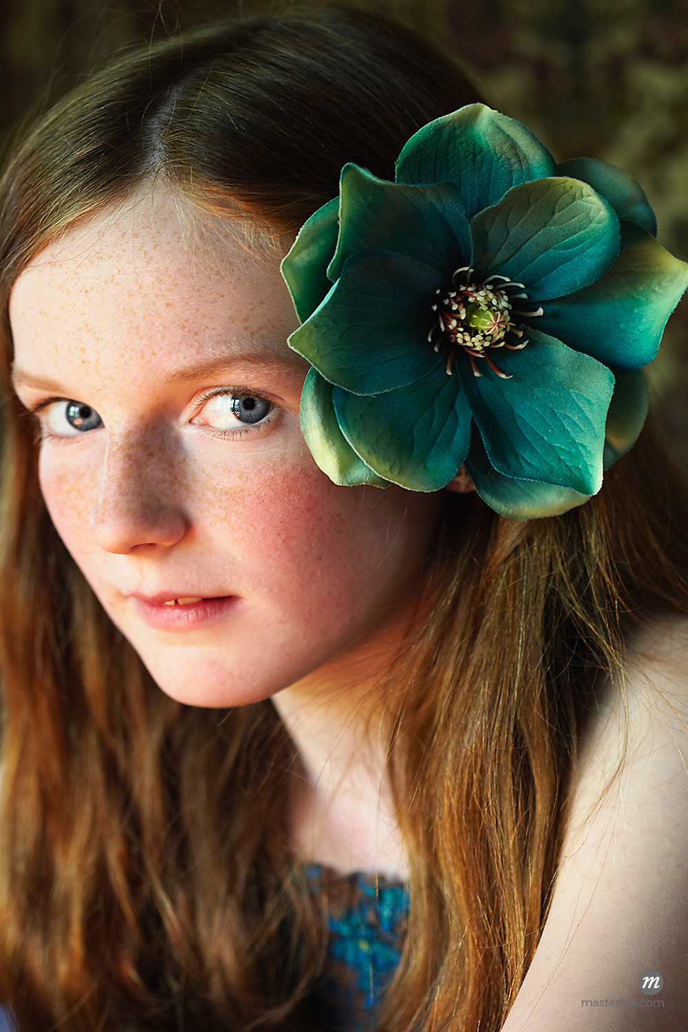 Portrait of Girl with flower  © Susan Findlay / Masterfile