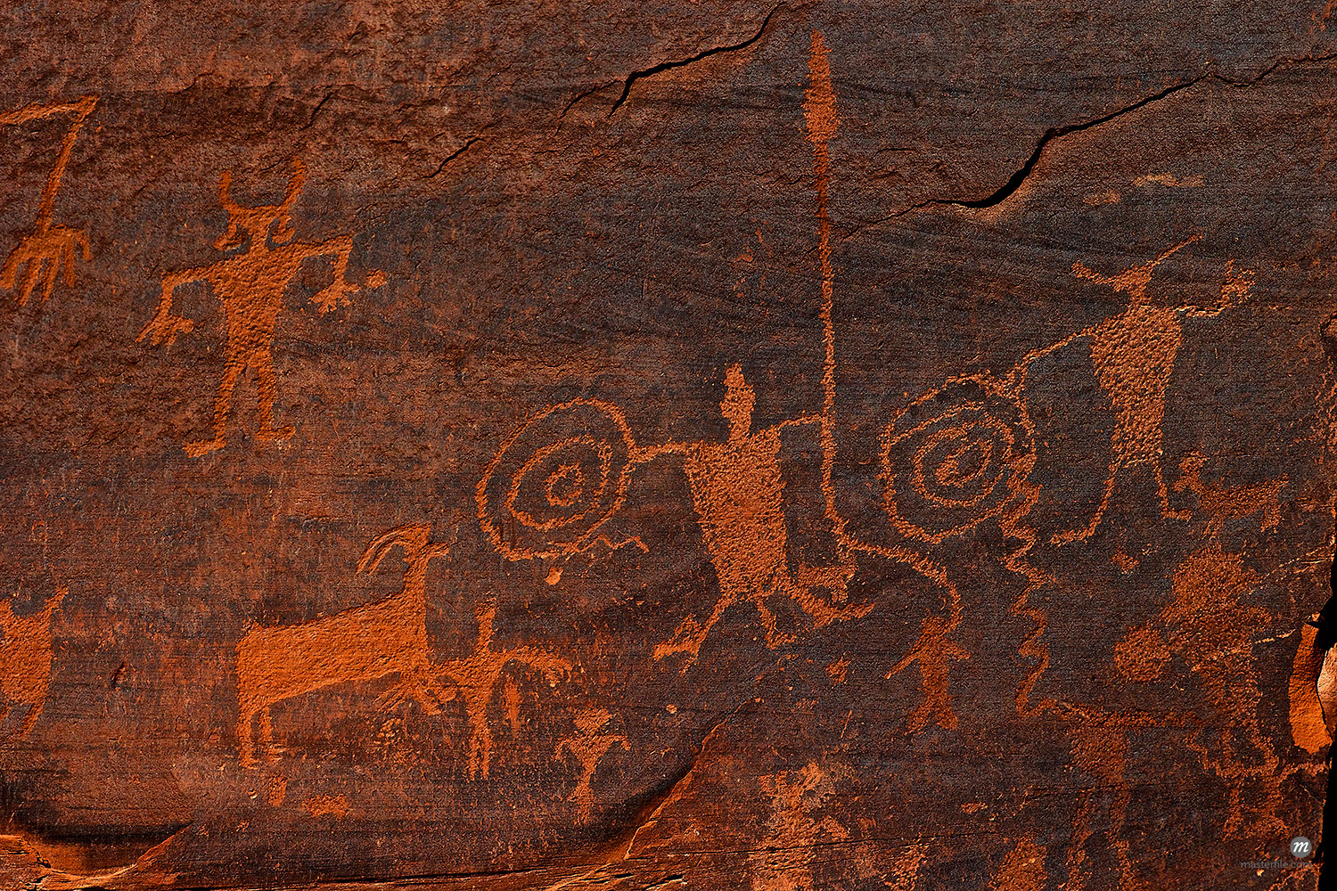 Horned anthropomorphs holding shields, Formative Period Petroglyphs, Utah Scenic Byway 279, Potash Road, Moab, Utah, United States of America, North America  © Robert Harding / Masterfile