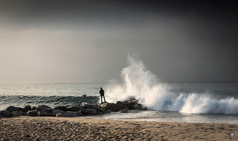 Fisherman on beach in California in early morning © robertharding / Masterfile